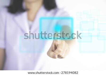 Nurse pressing modern buttons show technology of medical - stock photo