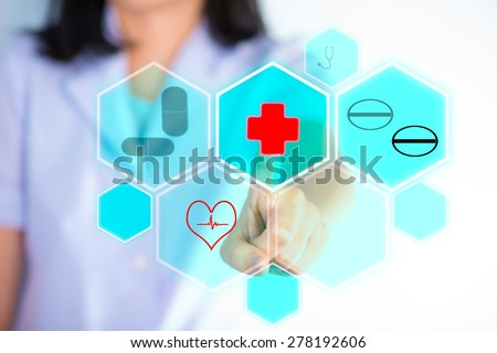 Nurse pressing modern medical type of buttons show technology of medical