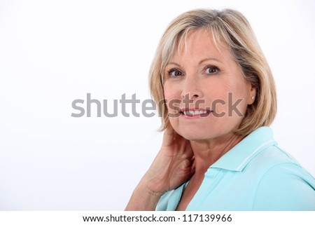 Nurse rubbing her neck, - stock photo