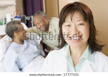 Nurse Smiling In Hospital Room - stock photo
