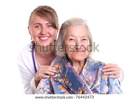 Nurse smiling with an elderly women - stock photo