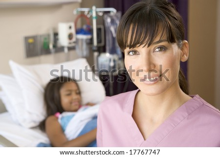 Nurse Standing In Hospital Room