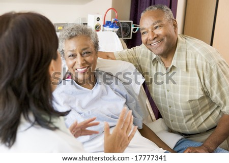 Nurse Talking To Senior Couple - stock photo