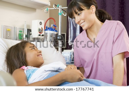 Nurse Talking To Young Patient - stock photo