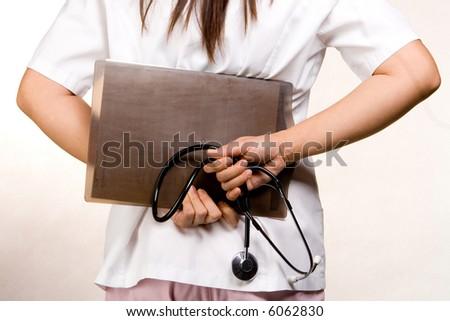 Nurse with a board - stock photo