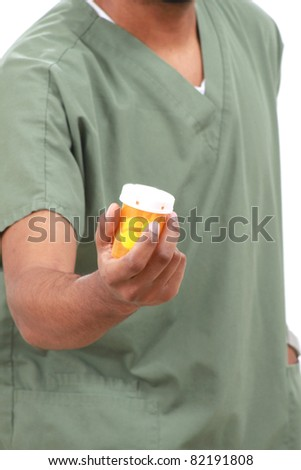 Nurse with a bottle of pills - stock photo