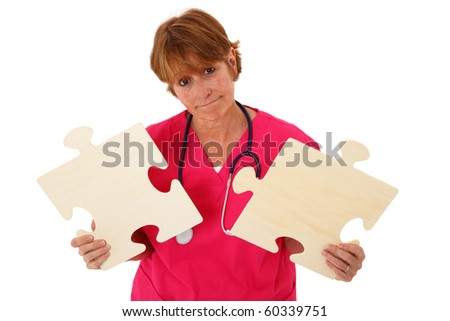 Nurse With A Concerned Face Holding Two Puzzle Pieces - stock photo