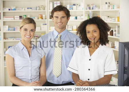 Nurse working on computer in pharmacy