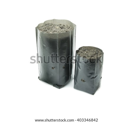 nursery bags with a soil on white background - stock photo
