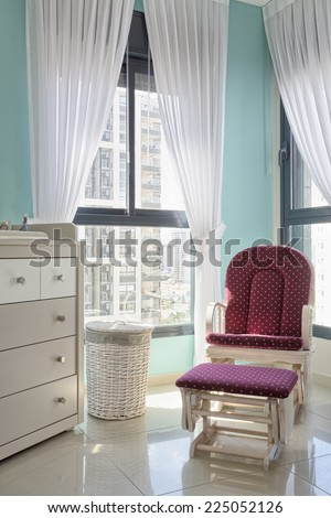 Nursery room for baby with window and curtain  - stock photo