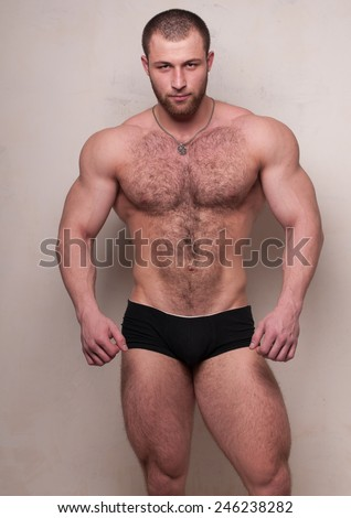 Nuscled male model with body hair  - stock photo