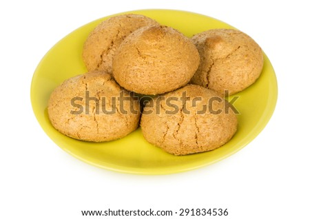 Nut-almond biscuits in yellow saucer isolated on white background - stock photo