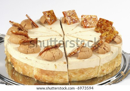 Nut cake with cream stuffing and peanuts in caramels - stock photo