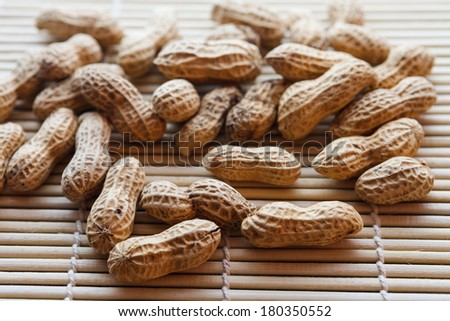 Nut peanut groundnut on wood. - stock photo