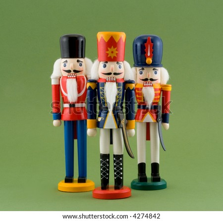 Nutcracker Soldiers Isolated on Green - stock photo