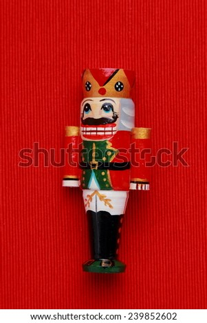 Nutcrackers in the form of wooden carvings of a soldier/Wooden toy nutcracker - stock photo