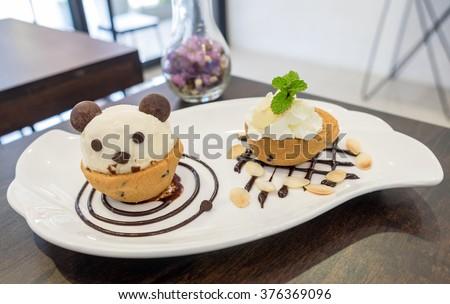 Nutella cookie cup ice cream panda on chocolate decor dish - stock photo