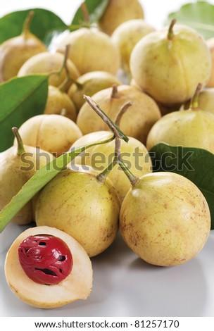 nutmeg fruits on plain background, studio shot - stock photo