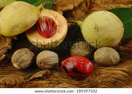 nutmeg fruits on wooden background - stock photo