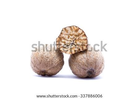 Nutmeg isolated on white background closely. - stock photo