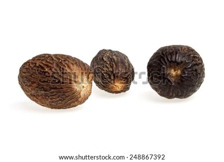 Nutmeg on a white background - stock photo