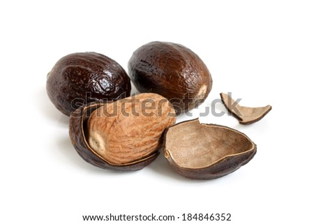 Nutmeg on white background - stock photo
