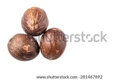Nutmeg over white background - stock photo