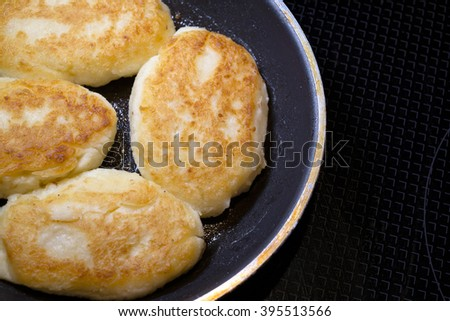 Nutrient ruddy fried potato pancakes in the shape of patties laid out in a pan and cooked just to eating food at the family dinner. The dish is part of a popular delicious Ukrainian cuisine. - stock photo