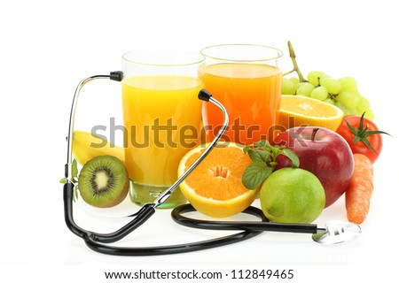 Nutrition and healthy eating. Fruits, vegetables, juice and stethoscope