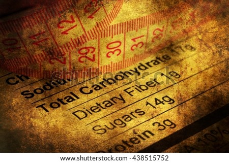 Nutrition facts and measure tape grunge concept - stock photo