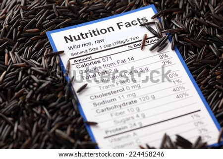 Nutrition facts of raw wild rice with wild rice background  - stock photo