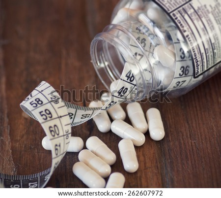 Nutritional supplements in capsules. Selective focus, shallow DOF - stock photo