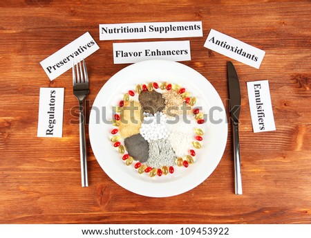 Nutritional supplements on wooden background close-up - stock photo