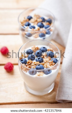 Nutritious and healthy bio yogurt with blueberries and cereal