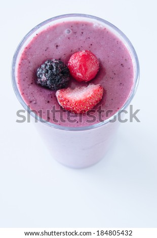 Nutritious berry smoothie garnished with frozen berries