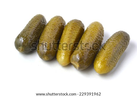 nutritious pickled gherkins on white background - stock photo