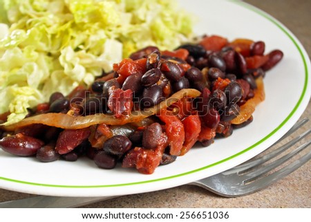 Nutritious vegetarian chili with a fresh garden salad - stock photo