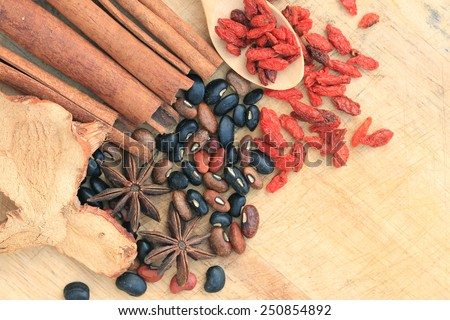 Nuts and chinese herb on wood background. - stock photo