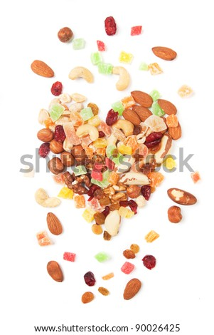 Nuts and dried fruit isolated on white background - stock photo