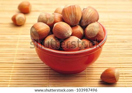 Nuts in ceramic bowl - stock photo