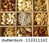 Nuts in wooden box - stock photo