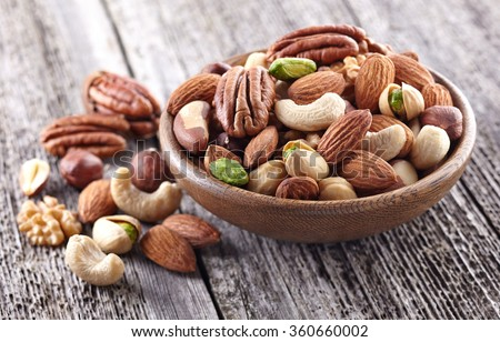 Nuts mix on a wooden background - stock photo