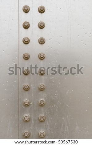 nuts on metal plate - stock photo