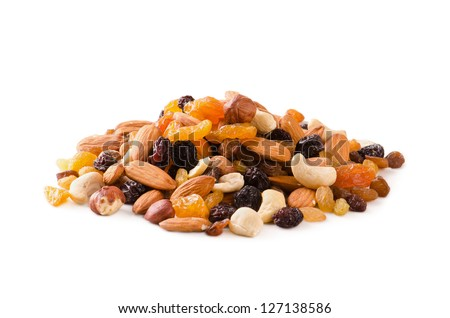 Nuts with raisins in white background. - stock photo