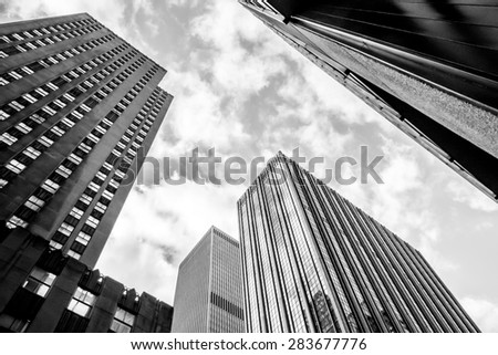 NY - Manhattan 31 dec 2014: Classic view of unidentified skyscraper from street to sky in manhattan - stock photo