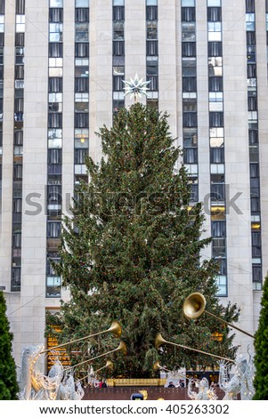 NY - MANHATTAN, 31 DEC 2014: Famous Christmas tree in front the Rockefeller Center in Manhattan - stock photo