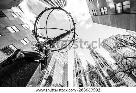 NY - Manhattan 31 dec 2014: Prospective of statue in front Rockefeller center whit St. Patrick church in background  in manhattan - stock photo