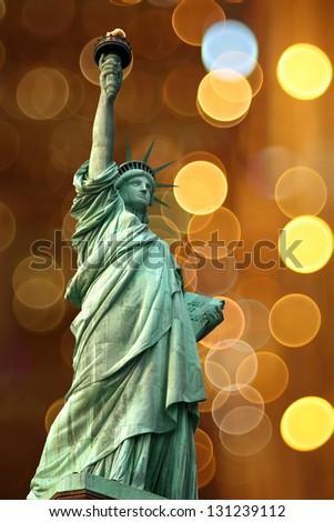NY Statue of Liberty against holidays flash circle - stock photo