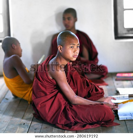 NYAUNG SHWE, SHAN STATE, MYANMAR - JANUARY 13: Novice monk learning in the Shwe Yan Pyay Monastery school on January 13, 2012 in Nyaung Shwe village, Myanmar.