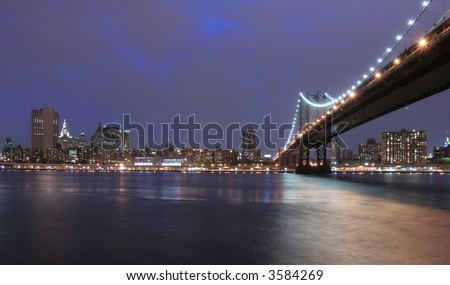 NYC and Manhattan Bridge at night